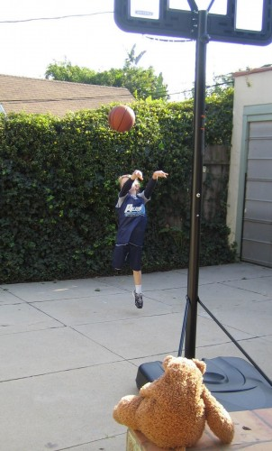 kid playing basketball