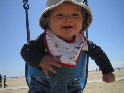 baby in beach swing