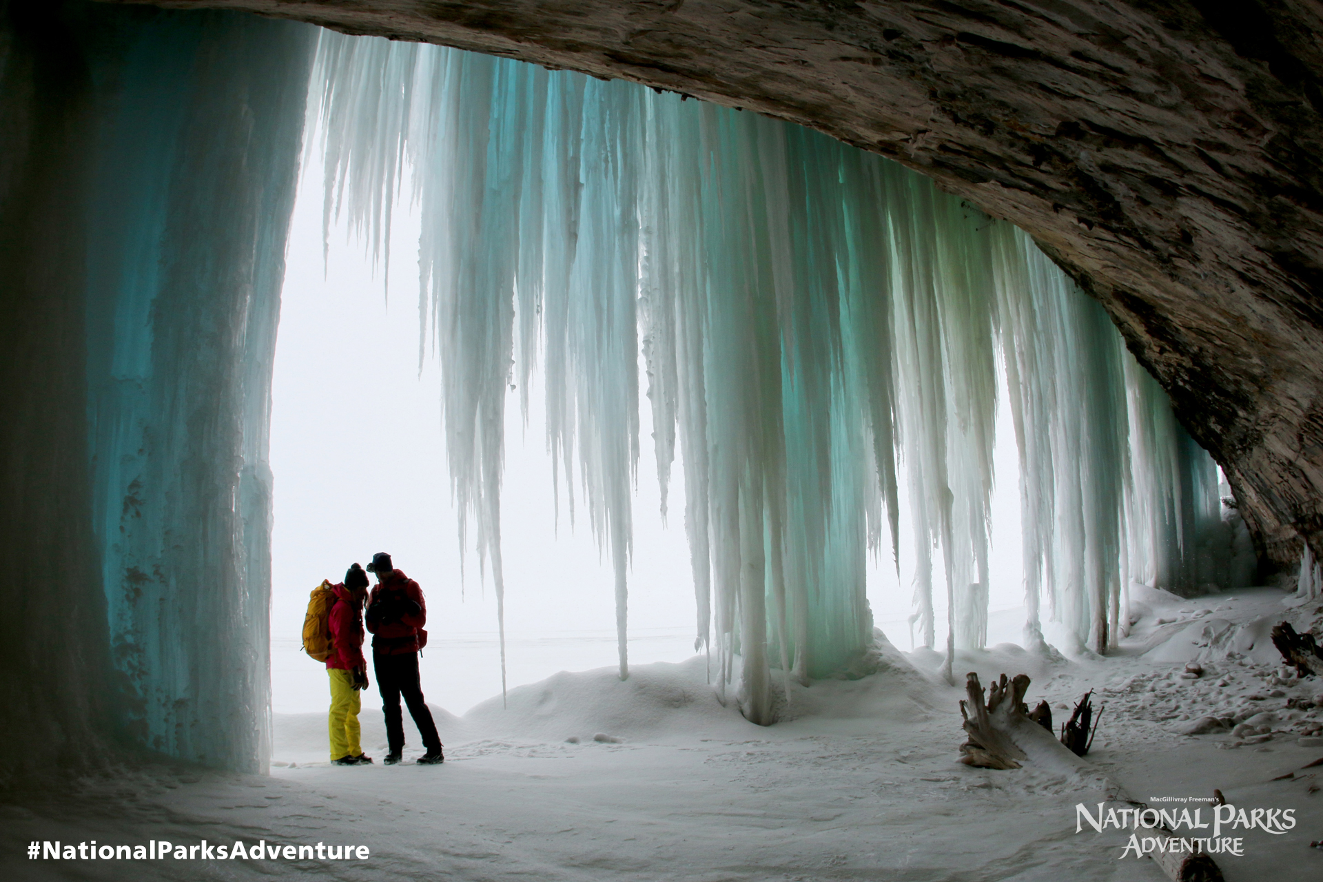 Max Lowe and Rachel Pohl explore a cave behind a frozen waterfall in Pictured Rocks National Lakeshore in Michigan. Courtesy of MacGillivray Freeman Films. Photographer: Barbara MacGillivray ©VisitTheUSA.com
