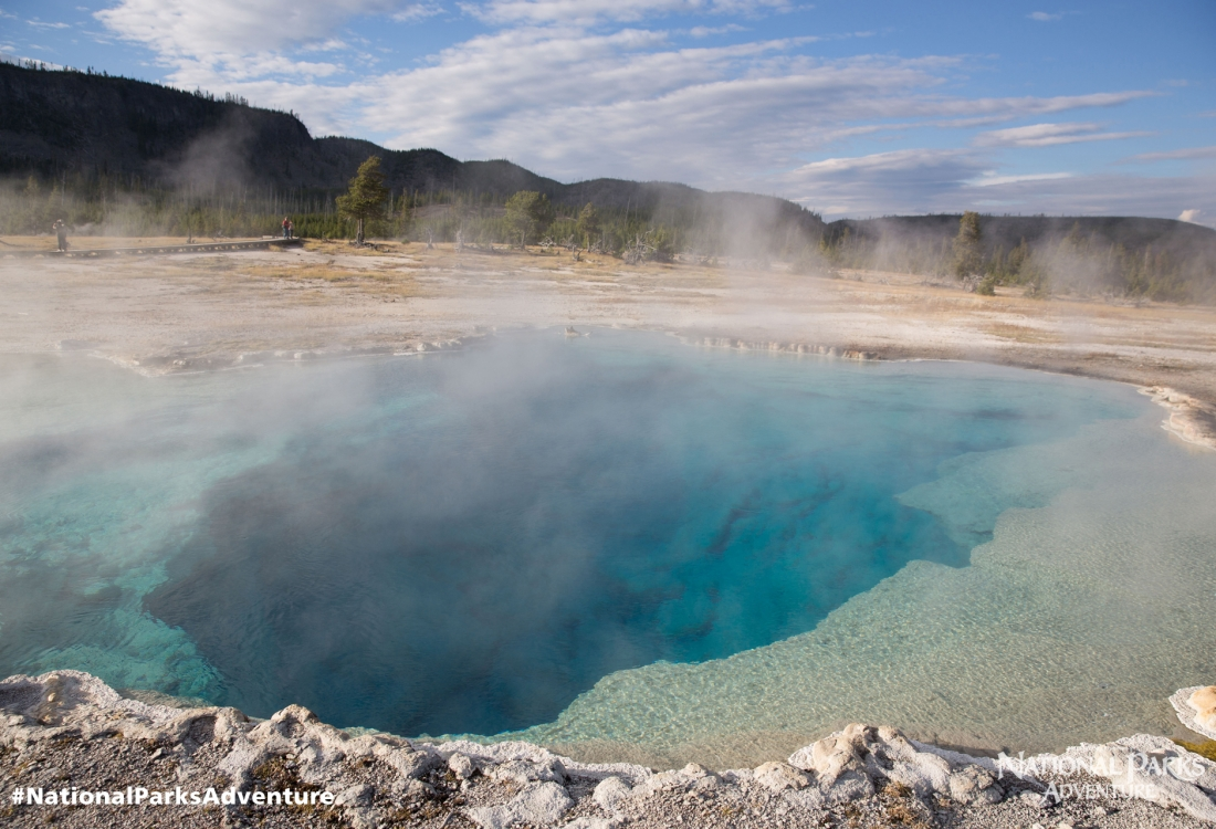 Steam rises from the Sapphire Pool in Biscuit Basin in Yellowstone National Park in Wyoming. Courtesy of MacGillivray Freeman Films. Photographer: Brad Ohlund ©VisitTheUSA.com